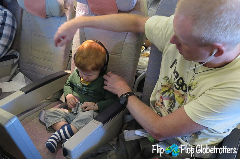 FlipFlopGlobetrotters.com - Blog: tips for flying with infants and toddlers - infant on a plane with dad