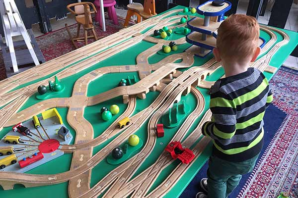FlipFlopGlobetrotters.com - blog: day trip to Haarlem Netherlands with kids - wooden train tracks at Pippa's