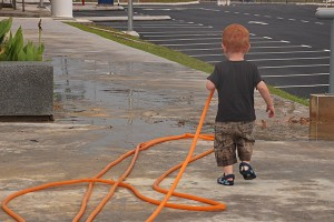 Jace at EV World Hotel in Kuala Lumpur. Who needs toys when there's a garden hose lying around...