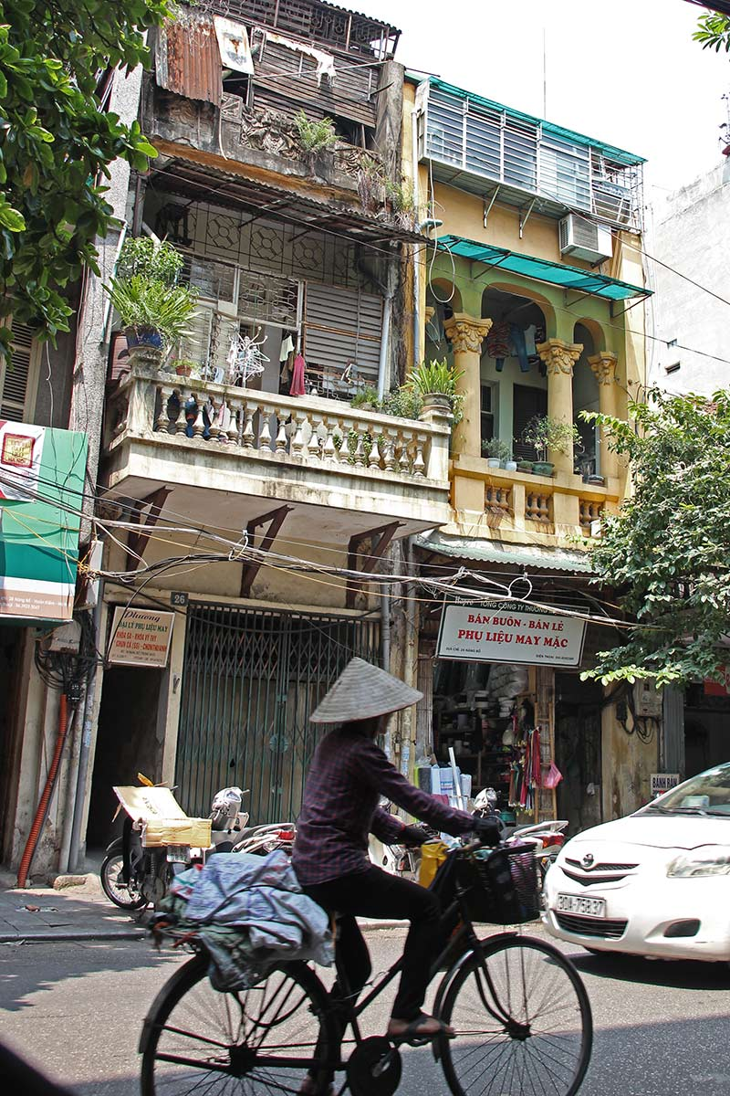 You see these really narrow houses everywhere in Vietnam. Apparently they pay taxes based on how much of their property borders the public street.