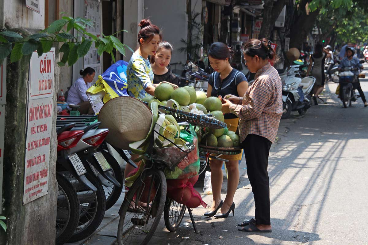 Here's a lady selling fruit, again using a bike to transport her products