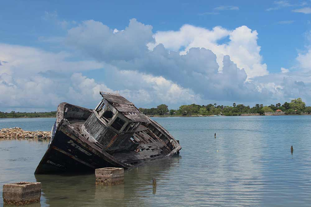 A lot of our scooter ride around Jaffna was on the coast near the sea. Here's an abandoned boat we found near one of the fishing villages