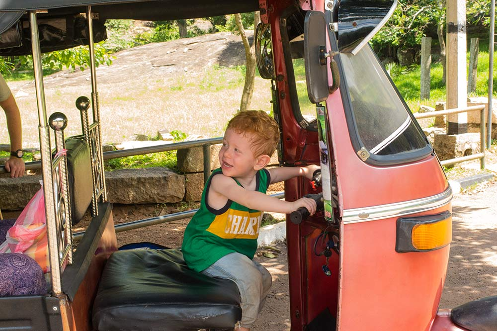The tuktuk driver in Anuradhapura let Jace play in his tuktuk. He loved it!