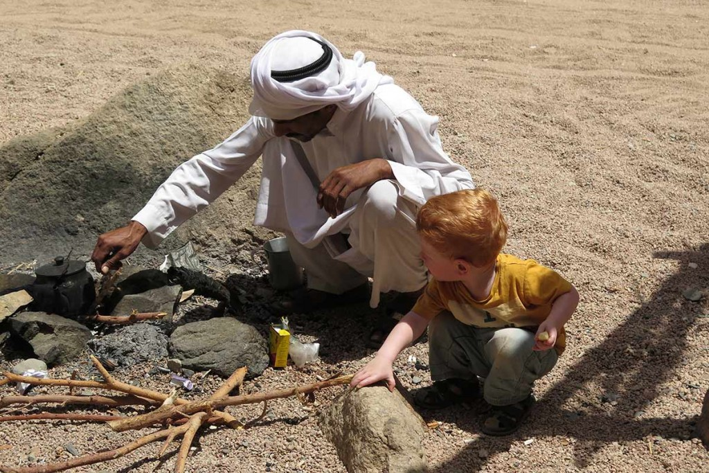 We love this picture of our little boy with our bedouin driver Eid, taken when we were at the oasis in Dahab