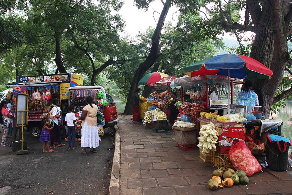 Near the Temple of the Tooth there are a lot of street vendors. We bought some fresh mango for Jace