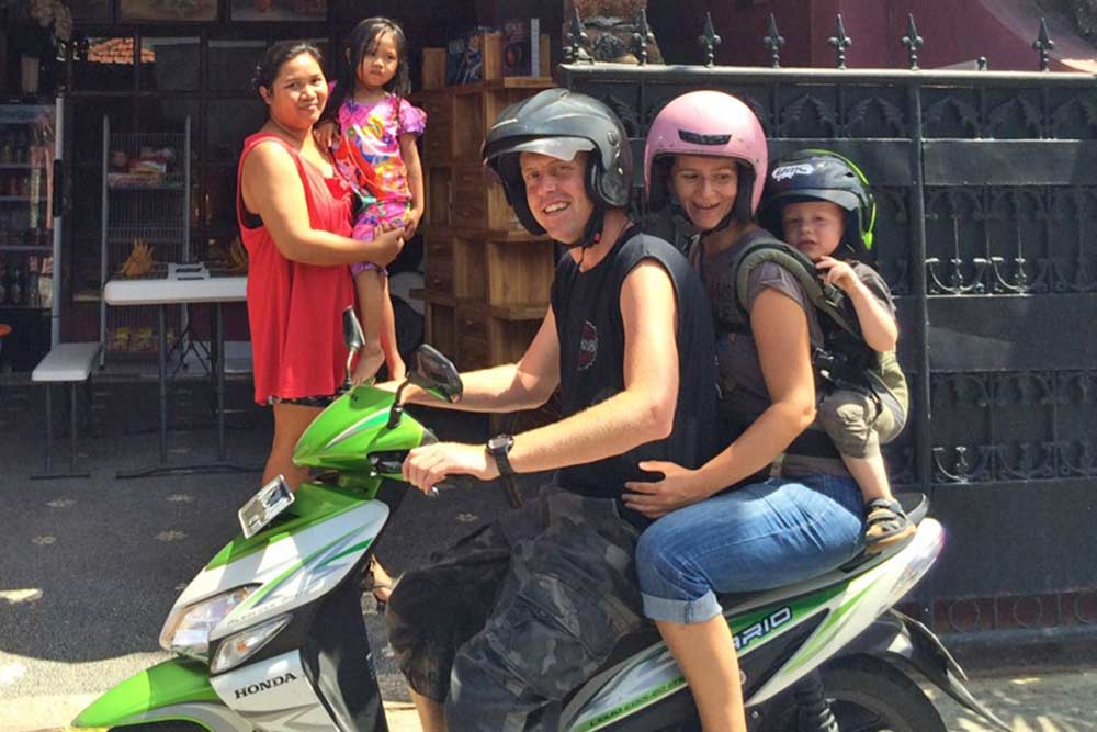 Together on a motorbike. With Jace in the Manduca wearing his own funky green motorbike helmet