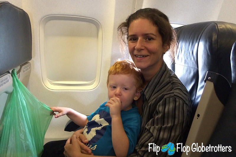 FlipFlopGlobetrotters.com - Blog: tips for flying with infants and toddlers - mom and child on a plane