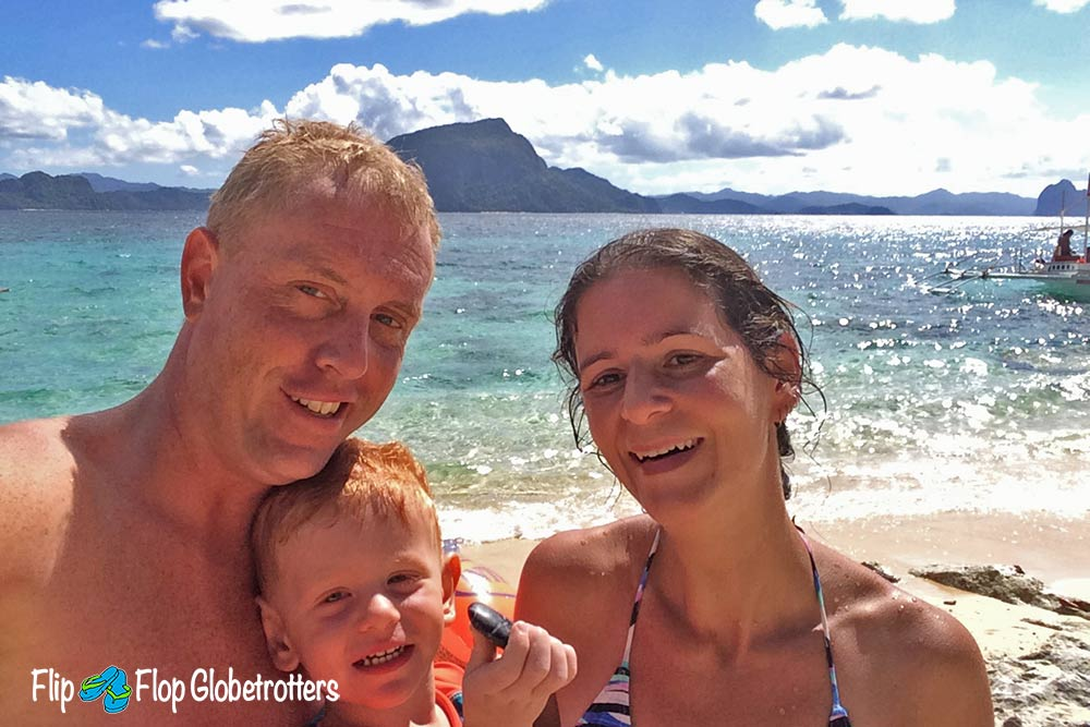 FlipFlopGlobetrotters.com - Blog: what's it like to travel with an infant? Family on beach