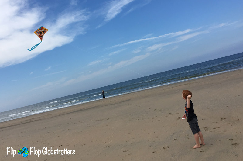 FlipFlopGlobetrotters.com - Things to do in Haarlem with kids - boy flying a kite at Zandvoort beach