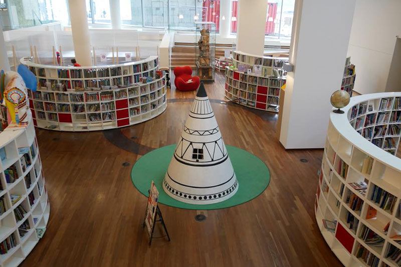 FlipFlopGlobetrotters.com - Things to do in Amsterdam with kids - public library tipi tent bookcases