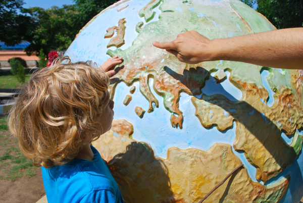 FlipFlopGlobetrotters.com - Worldschooling: how to make the world your classroom - boy with globe