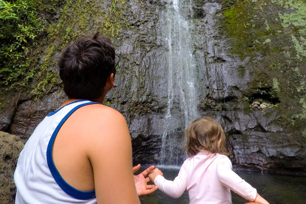 FlipFlopGlobetrotters.com - best places to visit in usa with kids - Oahu Hawaii small girl at waterfall