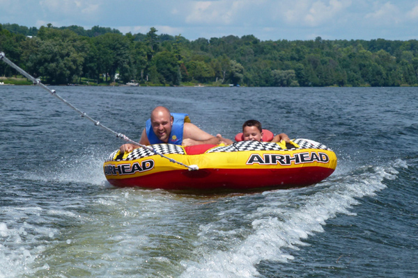 FlipFlopGlobetrotters.com - best places to visit in canada with kids - Keene Ontario tubing on Rice Lake